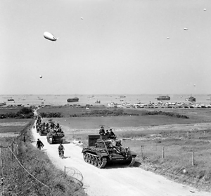 Tanks driving up the roads after landing at Gold Beach. (cae2k.com)