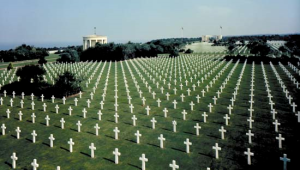 White crosses as far as the eye can dot the landscape of Normandy. (Hellfire and Brainstorm)