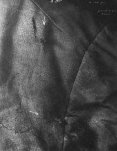 Infrared photograph of Senator Kennedy's coat, showing the bullet holes and powder burns. (California State Archives)