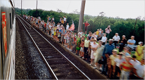 Thousands of people lined the tracks from New York to Washington, D.C. to see Robert F. Kennedy's funeral train. (NY Times)