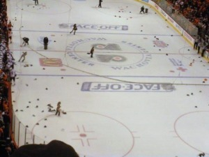 492 hats rain down on the ice after Mike Richards' second career hat trick. (Candice Monhollan)