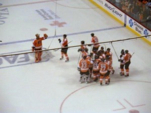 The Philadelphia Flyers celebrate their overtime win against the Washington Capitals. (Candice Monhollan)