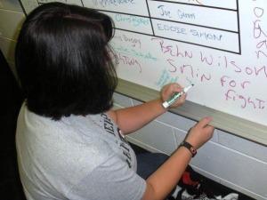 Lauren Pizzi leaves her mark on the coach's board. (Candice Monhollan)