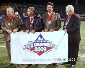 (From left to right) Dan Wildonger, Jerry Ware, Jay Landis and Jimmy Gruber hold up their fifth consecutive World Champions banner. (Wendy Monhollan)