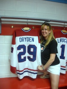 Candice Monhollan posing by a replica of one of her all-time favorite goaltenders. (Heather Morton)