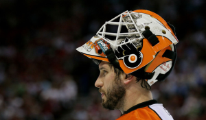 Goaltender Michael Leighton, who was re-signed over the summer, will now miss up to two months. (Jim McIsaac/Getty Images)