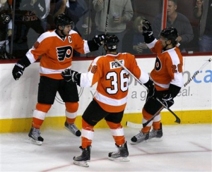 The Philadelphia Flyers are stacked down the middle with players like Mike Richards, Claude Giroux and Darroll Powe. (AP)
