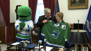 Gov. M. Jodi Rell, along with Pucky the mascot, help to unveil the sweaters for the new Connecticut Whale. (ctnow.com)
