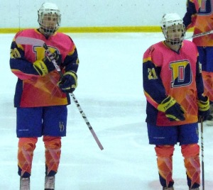 Sophomore Kyle Curley (left) and Junior Vincent Pontrello (right) with the special pink jerseys that were auctioned off during the game. (Candice Monhollan)