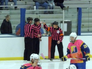 Though they weren't auctioned off, the referees also joined in with pink uniforms. (Candice Monhollan)