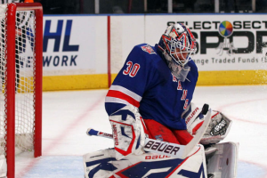 Henrik Lundqvist made 23 saves Sunday en route to the New York Rangers' first win of the series. (Bruce Bennett/Getty Images)