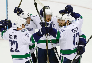 Henrik Sedin assisted in all four goals while Daniel Sedin assisted in three of them. (Jeff Vinnick)