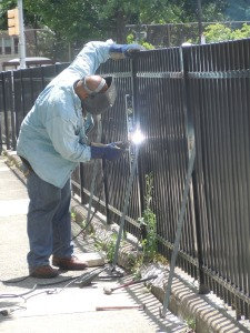 A maintenance man worked on sprucing up the appearance of Lea Elementary. (Candice Monhollan)