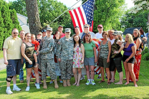 Family and friends gather around Jared Ash as they say farewell before he leaves for basic training. (Candice Monhollan)