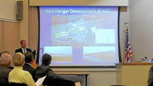 New Garden Flying Field Airport Manager Jon Martin speaks about the new hangar development during the township meeting on Sept. 23. (Candice Monhollan)