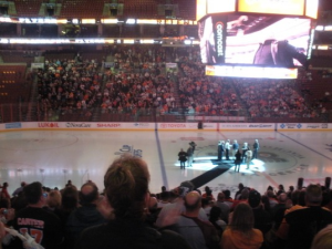Flyers alumni gather on the ice after the viewing. (Candice Monhollan)