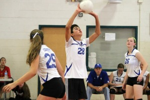 Kennett sophomore Justin Barish playing alongside his female teammates on the girls volleyball team. (Candice Monhollan)