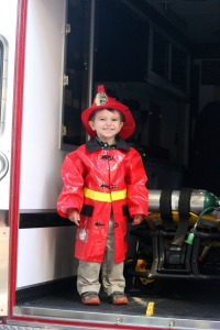 Nick Smalley, 2, explores the ambulance in his firefighter's costume at Longwood Fire Company's open house Oct. 20. (Candice Monhollan)