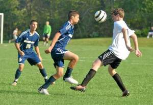 Spring-Ford's Dan DiLiberto, left, and Phoenixville's John Hopkins go for control of the ball during Tuesday's game at Charlestown Park. (Barry Taglieber)