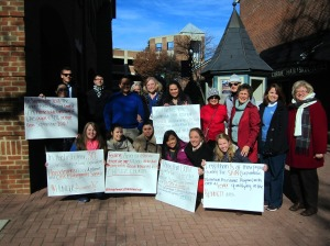 Participants of the Walk for Homelessness share statistics through their handmade signs Nov. 20.  (Kathy Hrenko)