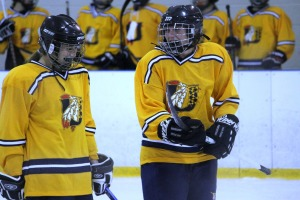 Kaelyn Murphy, right, scored her first goal as an ice hockey player Nov. 22.