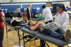 Students at Kennett High School donate blood to the Red Cross Dec. 19. (Candice Monhollan)