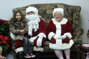 Kayleigh Stevens, 7, visits Santa and Mrs. Claus in Oxford at their annual Country Christmas event on Dec. 6. (Candice Monhollan)