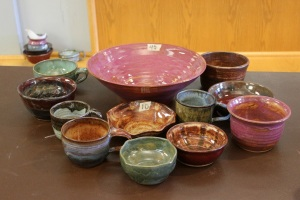 Students in ceramics made pottery mugs and bowls to sell to raise money for the class. (Candice Monhollan)