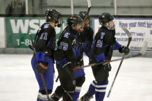 Teammates congratulate Ryan Johnson on his goal to take the lead in the first period against Avon Grove Dec. 20. (Candice Monhollan)