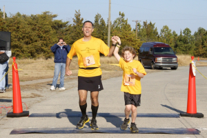 "Father Dan and son Nikolas Toocheck finish their first marathon in Delaware to kick off the ""Running the World for Children"" cause. (Nikolas Toocheck)"