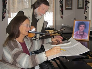 Donna Beech studies the music which will be played and sung at the Jonathan Beech Memorial Concert along with her husband. (Donna Beach)