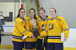 Unionville captains celebrate with the ICSHL championship trophy after defeating Conestoga, 5-2, on Monday night at IceLine in the final. (Candice Monhollan)