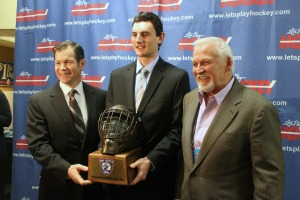 Sophomore Connor Hellebuyck, center, with Mike Richter, left, and Bernie Parent, right, after winning the 2014 Mike Richter award. (Candice Monhollan)