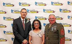 From left to right, Philip Reggio, Grace Frunzi and Mastery Gunnery Sergeant Andrew Worley each won the Citadel Heart of Learning award for middle school, elementary school and high school, respectively. (Citadel)