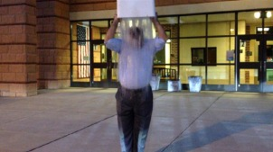 Unionville-Chadds Ford school board President Victor Dupuis accepted the ALS Ice Bucket Challenge and dumped the frigid water on his head after the board meeting Aug. 18. (Candice Monhollan)