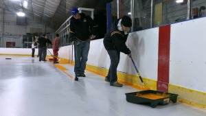 Volunteers and Upland employees spend their afternoon painting the ice. (Candice Monhollan)