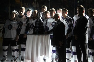 Members of the Cup-winning Reading Royals team celebrate the banner raising at the home opener. (Candice Monhollan)