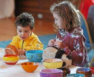 Will, left, and Sophie Warner pick out ceramic bowls at Immaculata University's Empty Bowls event in the Great Hall on Thursday. Proceeds from the event benefit the West Chester Food Cupboard. (Vinny Tennis)