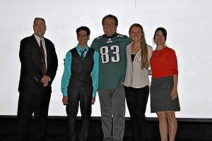 Vince Papale and Shay Sinha hosted an assembly for West Chester Henderson High School about overcoming the odds and never giving up. From left are, Principal Jason Sherlock, junior Shay Sinha, Vince Papale, Julianne Rodgers and Liz Linton. (Candice Monhollan)