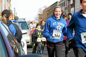Hundreds of runners took over the streets of West Chester Saturday morning for the St. Agnes Catholic School third annual 5K Family Fun Run. (Pete Bannan)