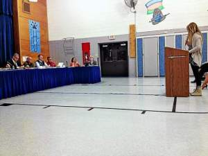 """Kennett High School student Vikki Epps speaks to the school board in favor keeping the book """"Nineteen Minutes"""" in the school's library. (Candice Monhollan)"""