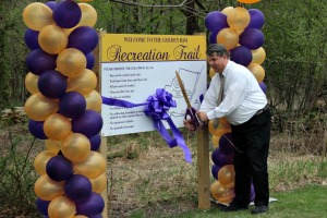 Richard Przywara, executive director of the University Student Housing at West Chester University, cut the ribbon to officially open the new trail on South Campus. (Candice Monhollan)