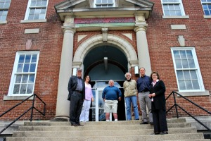 Uptown! Entertainment Alliance has raised over half the money it needs to turn the old National Guard Armory in West Chester into a theater for film and live performances. From left: Richard May, Leslie Telthorster, Jimmy Jefferis, Roy Smith, Tom McEvoy and Angela Scully. (Candice Monhollan)