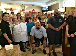 New Haven Pizza owners Teddy, Bessie and Don Bottos gather with local firefighters and West Chester Mayor Carolyn Comitta as a thank you for saving their business from a fire. (Candice Monhollan)