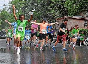Over 2,800 Chester County girls and their families turned out Saturday for the Kids on the Run 5K. Runners cooled off from a hose at the rear of the West Chester YMCA Oscar Lasko youth program center Walnut Street. (Pete Bannan)