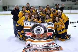 Unionville celebrates clinching the Flyers Cup Girls title with an 8-2 win over West Chester East at Ice Line Monday night. (Candice Monhollan)