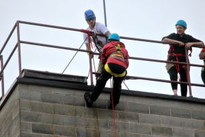 People who will participate in the big rappel in Philadelphia had the chance to do a five-story practice in West Chester on Sept. 10. (Candice Monhollan)