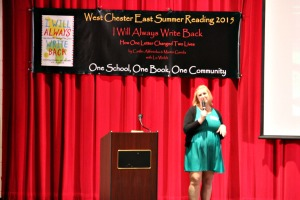 """Caitlin Alifirenka, co-author of """"I Will Always Write Back,"""" visits West Chester East High School to talk about her book and how one letter changed her life. (Candice Monhollan)"""