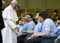 Pope Francis greets inmates during his visit to Curran Fromhold Correctional Facility in Philadelphia, Sunday, Sept. 27, 2015. (David Maialetti — Pool Photo/The Philadelphia Inquirer)