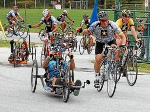 Bicyclists arrive at Schramm Inc. in West Goshen on Wednesday, Sept. 30, 2015. Schramm Inc. hosted veterans who are bicycling from West Point to Annapolis for Ride 2 Recovery. (Vinny Tennis)